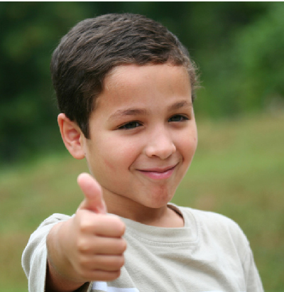 """Boy giving the """"thumbs up"""" sign."""