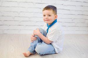 Boy child sitting