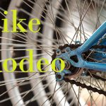 Bike spokes with yellow words Bike Rodeo