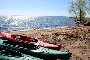 Three kayaks on the beach