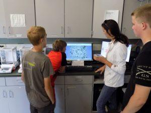 Kids looking at a monitor